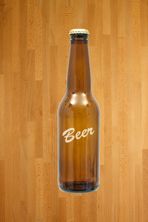 Bottles of beer isolated against a wooden background Stock Photo - 10011696