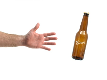 grabing: Bottles of beer isolated against a white background Stock Photo