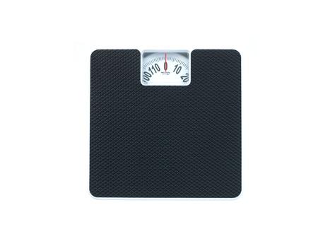 体重計の白い背景に対して分離 写真素材