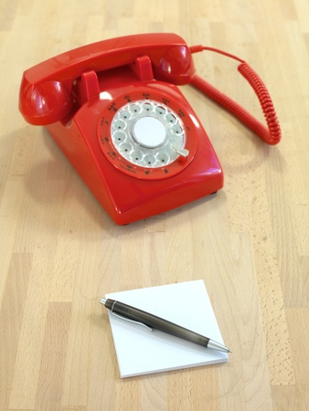 A vintage rotary telephone on a desk Stock Photo - 10057340