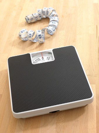 bathroom scale: Bathroom scales isolated against a white background