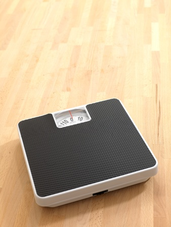 Bathroom scales isolated against a white background photo