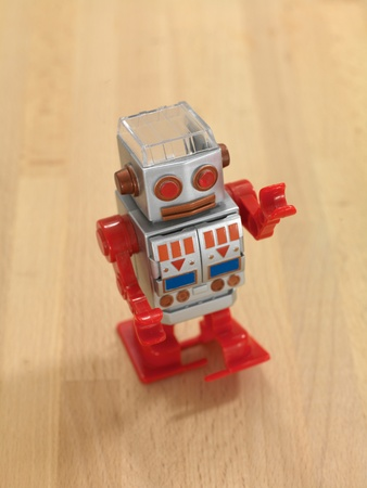 A robot walking on a wooden floor Stock Photo - 10139249