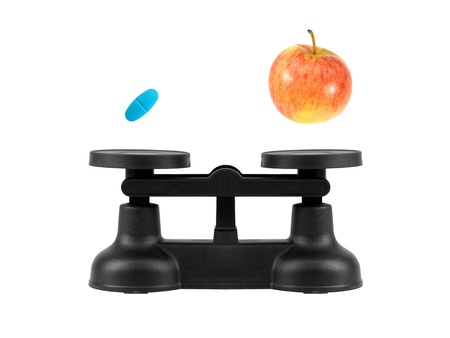 Kitchen balance scales isolated against a white background Stock Photo - 10139382