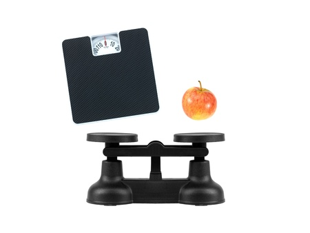 Kitchen balance scales isolated against a white background Stock Photo - 10138826