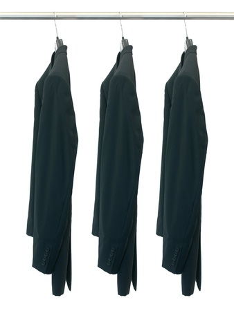 Garments hanging on coat hanger isolated against a white background photo