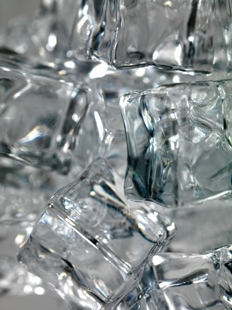 Frozen ice cubes isolated on a kitchen bench photo