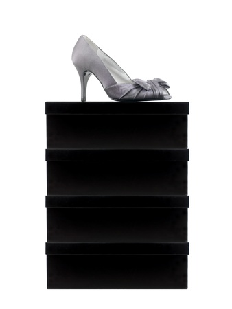 Ladies high heeled shoes isolated against a white background photo