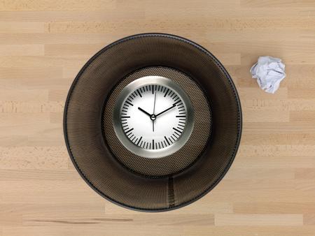 useless: A trash bin isolated on a wooden floor