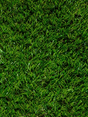 A close up image of artificle grass photo
