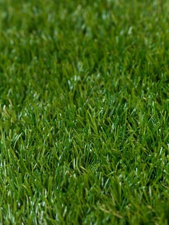 pasto sintetico: Cerrar una imagen de hierba artificle