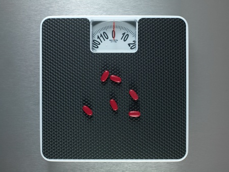 Bathroom scales isolated against a metallic background photo
