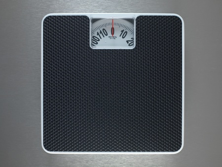Bathroom scales isolated against a metallic background Stock Photo