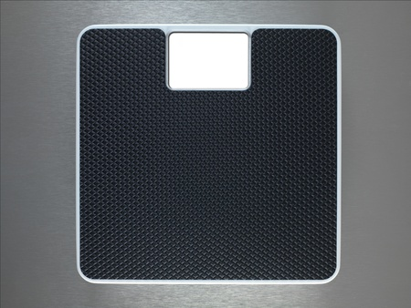 weight room: Bathroom scales isolated against a metallic background Stock Photo