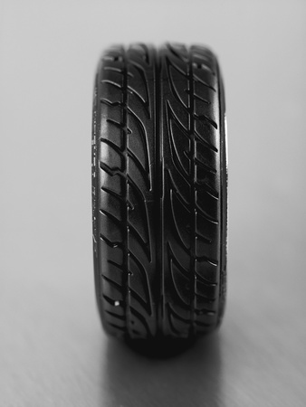 Rubber tyres with sports rims on a silver background Stock Photo - 10486086