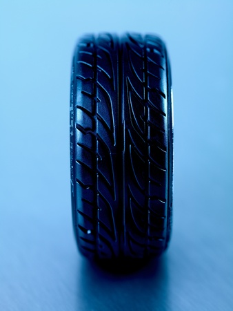 Rubber tyres with sports rims on a silver background Stock Photo - 10486078