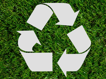 A recycle symbol with green leaves on white photo