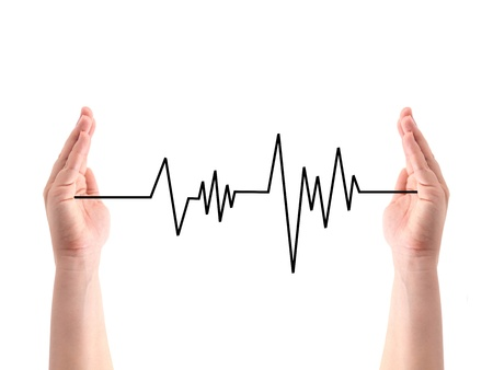 A heart rate line between two hands