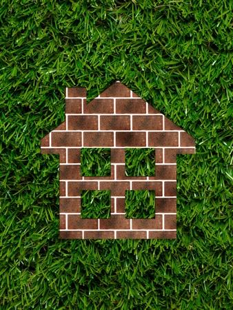 A conceptual cutout house of red bricks photo