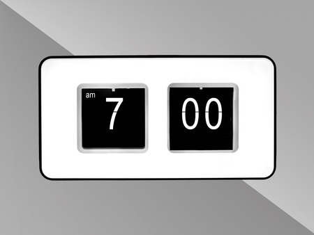 A flip clock isolated against a red background Stock Photo - 10614269