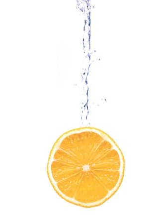 Citrus fruit and flowing water isolated against a white background photo