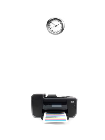 A desktop printer and clock isilated on white photo