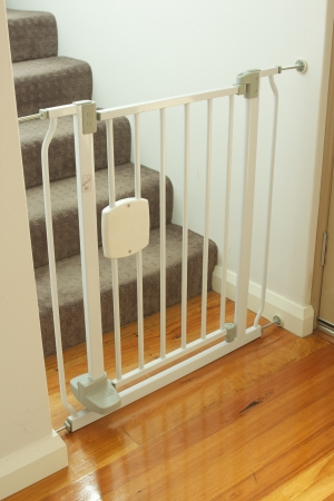 A shot of a child safety gate and stairs Stock Photo