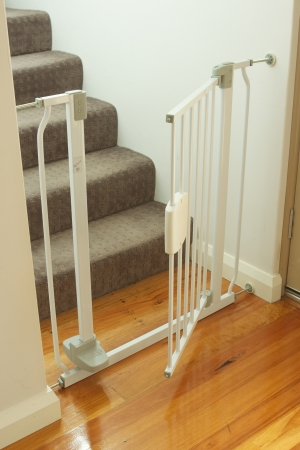 A shot of a child safety gate and stairs Standard-Bild