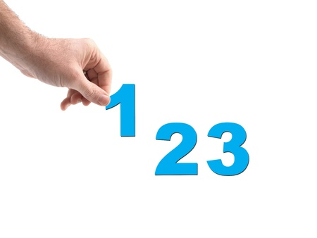 Numbers held by a hand isolated against a white background Stock Photo - 11787327