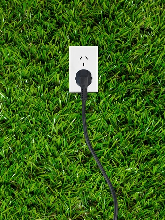 Conceptual renewable images isolated against artificial lawn photo