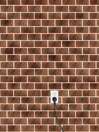 A power cord and outlet on a brick wall photo