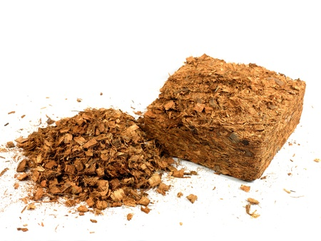 Garden wood chip mulch isolated against a white background photo