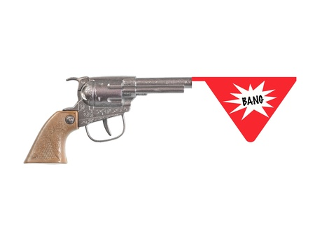A toy hand gun isolated against a white background photo