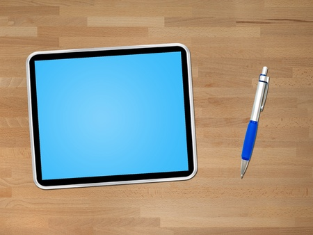 A computer tablet isolated against a wooden background Stock Photo - 12388735