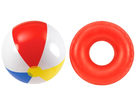 A beach ball and rubber tube together Stock Photo