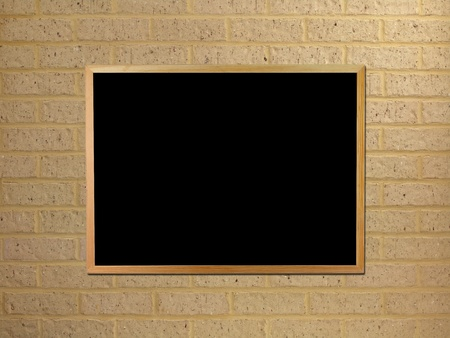 A black board mounted on a brick wall photo
