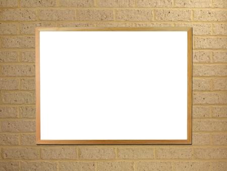 wall mounted: A black board mounted on a brick wall