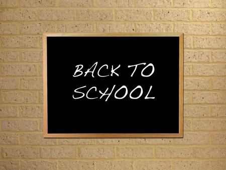 A black board mounted on a brick wall Stock Photo - 12697545