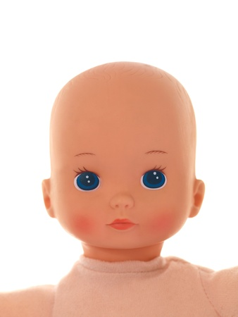 A toy doll isolated against a white background photo