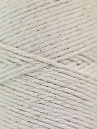 A close shot of a reel of string photo