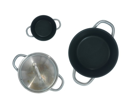 Pots and pans isolated against a white background photo