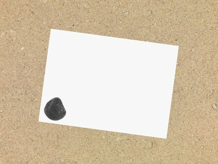 A conceptual image of items in beach sand photo