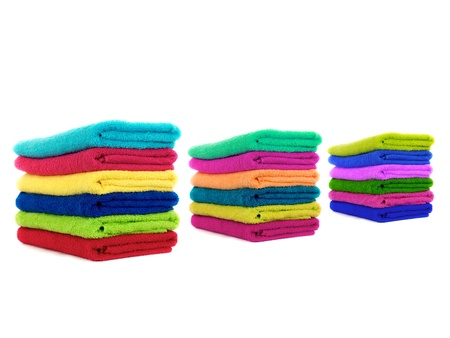 Colored towels isolated against a white background photo