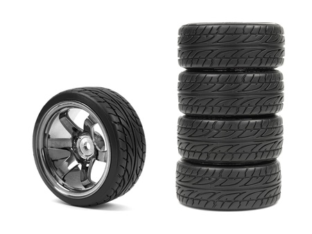 Rubber tyres with sports rims on a white background Stock Photo