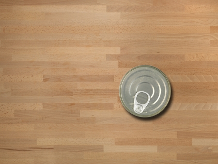 Canned tuna isolated on a wooden bench Stock Photo - 13777847