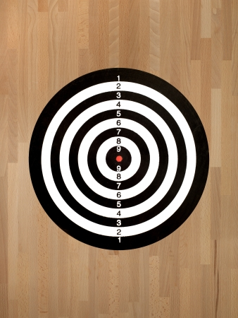 A target isolated against a wooden background photo