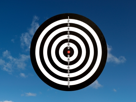 A target isolated against a blue sky Stock Photo