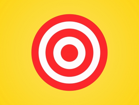 A target isolated against a yellow background photo