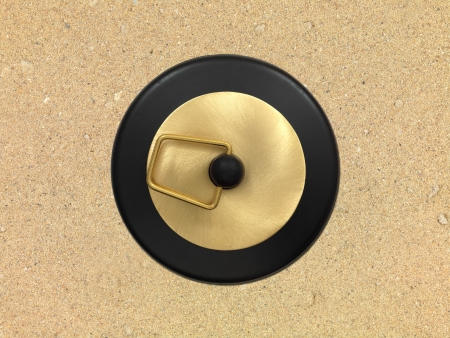A close up image of a drain hole plug photo