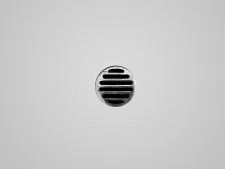 A drain hole isolate on a white background photo